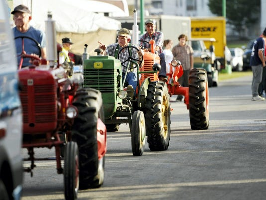 Tractors ride during a parade honoring first responders and military personnel on the anniversary of 9/11 at the York Fair last year. This year's parade will celebrate 250 years of the York Fair on Sunday, Sept. 13.