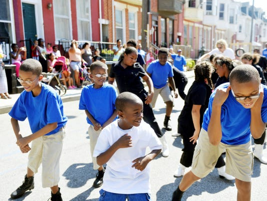 "From left, Marquan Carter, 11; Tymir Carter, 8; James Harley, 8; and Omarion Newson, 11, dance to ""Watch Me (Whip/Nae Nae)"" alongside the Southside Steppers youth drill team Saturday, during the one-year anniversary celebration of Sonny Simpson Play Zone's opening on the 500th block of South Duke Street in York. The play zone, which is dedicated to a longtime maintenance foreman at Crispus Attucks who died in 2002, was built in a former vacant lot by Crispus Attucks volunteers and Wells Fargo employees."
