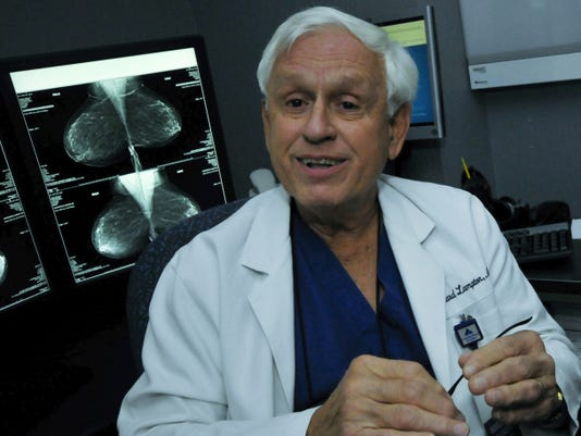 Dr. Edward Lampton Jr., seen in his office Thursday, has spent years treating breast cancer patients at Rhonda Brake Shreiner Women's Center.