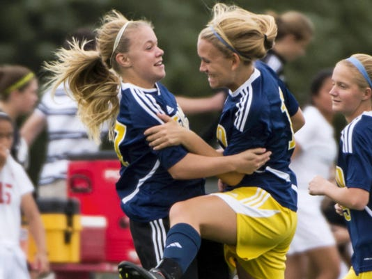 Elco's Taylor Bossert celebrates with freshman Julia Nelson during the Raiders' 4-0 win at Annville-Cleona on Wednesday.