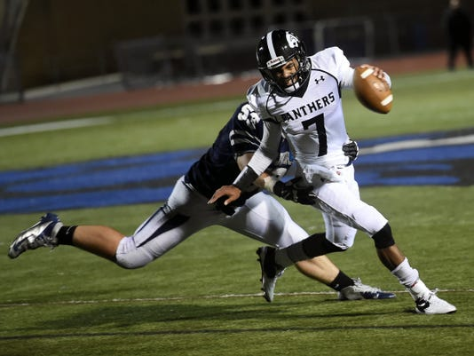 Chambersburg's Kelton Chastulik (53) catches up to quarterback Jahad Neibauer (7) of Central Dauphin East on Friday. Neibauer threw for for four TDs in a 42-3 victory.