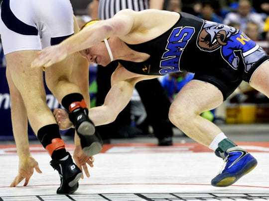Kennard-Dale's Chance Marsteller, right, chases Pittsburg Central Catholic's Kyle Coniker for a takedown in the PIAA Class AAA 170-pound championship bout on March 8. Marsteller defeated Coniker, 14-2, to win his fourth PIAA championship and complete his high school career with a perfect record.