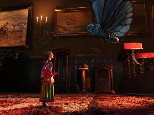 "Mia Wasikowska as Alice, left, and Absolem, voiced by Alan Rickman, appear in a scene from ""Alice Through The Looking Glass."""