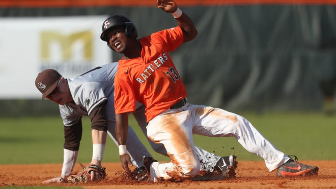 FAMU'sJordan Curtis slides safely into second base past Brown's Rich Ciufo after a caught fly ball during their game at Moore–Kittles Field on Friday, March 2, 2018.