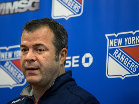 New York Rangers head coach Alain Vigneault answers a question as he speaks to members of the media at the Rangers Westchester training facility in Greenburgh, N.Y., Monday, June 1, 2015, in New York. The Rangers came up a game short of making the Stanley Cup finals for the second straight year.