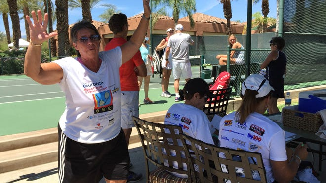 Rosie Casals directs the action at the Rosie Casals & Jackie Cooper Tennis Invitational at Indian Ridge Country Club on Sunday, April 26, 2015.