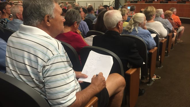 A member of the audience takes notes during a meeting of the Coachella Valley Water District's board in Palm Desert on Tuesday.