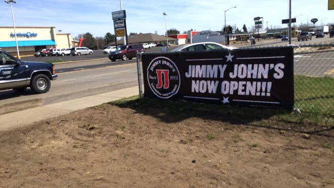 A banner on the Jimmy John's property at 2020 Eighth St. S. announces the opening of the gourmet sandwich shop.