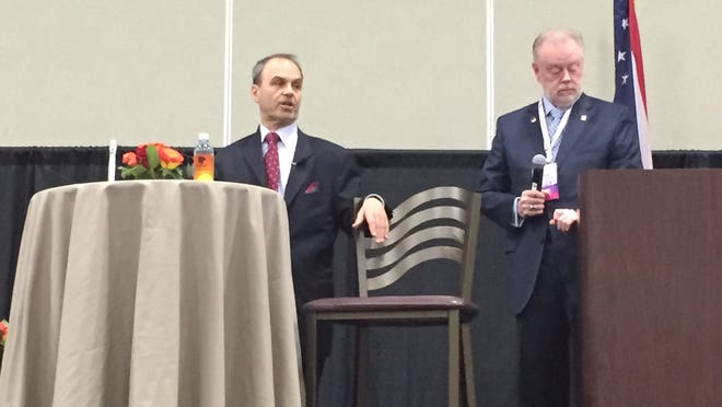 Author and attorney Scott Turow, left and Ohio Bar Association President Martin Mohler answer questions at the annual convention.