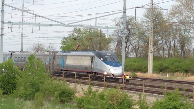 Emergency personnel investigate after a person was killed by an Amtrak train Thursday afternoon.