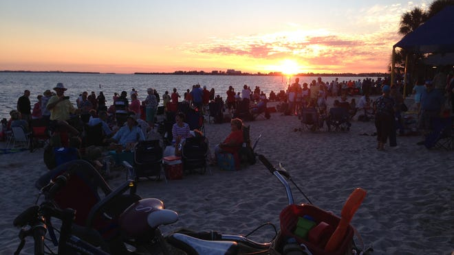 Environment: The sun sets over the Caloosahatchee River at Cape Coral's monthly Sunset Celebration.