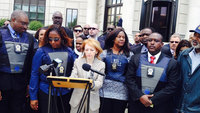 Four state parole officers have a federal lawsuit pending against Ramapo police, alleging they were racially profiled and held at gunpoint last year while on official business in Airmont. From left to right at a news conference last May: Parole officer Samuel Washington, parole officer Sheila Penister, lawyer Bonita Zelman, parole officer Annette Thomas-Prince and parole officer Mario Alexandre.