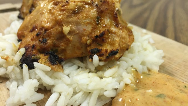 Indian-inspired tandoori chicken with a yogurt-based dipping sauce.