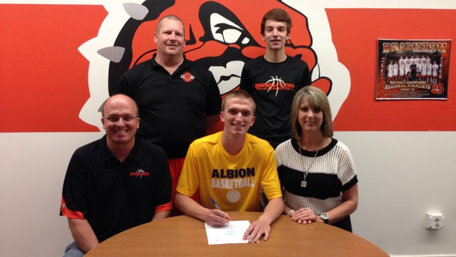 Brighton's Dylan Bennett seated at center, recently signed to play basketball at Albion College. He was flanked by his parents, Trevor and Staci. In the back are Brighton coach Mike Griest (left) and younger brother Noah Bennett.