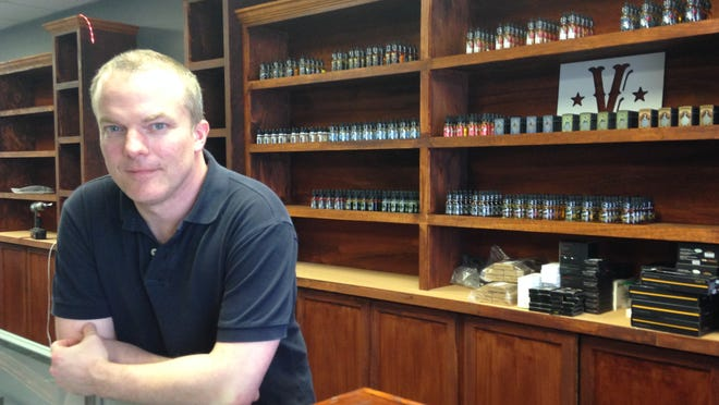 Manager Jeffrey Bouman in the new Victor Vapes store on Main Street.