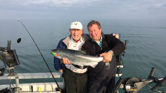 Red Cross derby founder Lou Langie Jr., left, and Capt. Jerry Felluca with a nice spring King salmon caught Tuesday, May 5, 2015, on Lake Ontario. The derby has raised nearly $1 million for Red Cross programs.