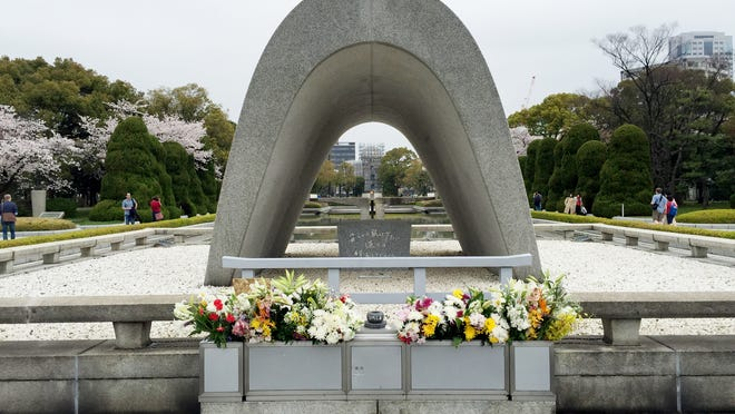 """The Cenotaph for the A-bomb Victims memorializes victims killed in the Aug. 6, 1945 bombing of Hiroshima. The monument is inscribed with the words, """"Let all the souls here rest in peace; For we shall not repeat the evil."""""""