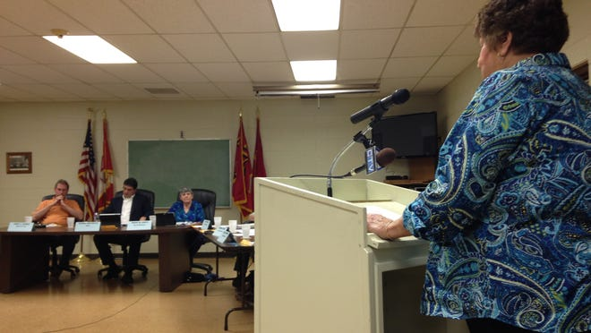 A resident speaks out against the special tax assessment during a Marine City Commission meeting Thursday.