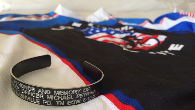 The six Metro police officers pedaling toward Washington, D.C. are wearing black bracelets stamped with the name of their fallen comrade, Officer Michael Petrina.
