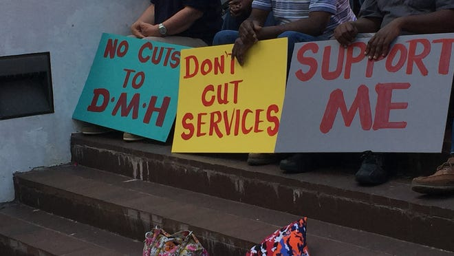 Nearly 200 people attended a rally at the Capitol on Wednesday to urge legislators not to reduce funding for mental health and disability programs.