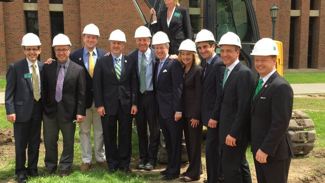 UVM trustees, university President Tom Sullivan, Gov. Peter Shumlin and Burlington Mayor Miro Weinberger pose at the groundbreaking for a new STEM complex on campus Friday afternoon.