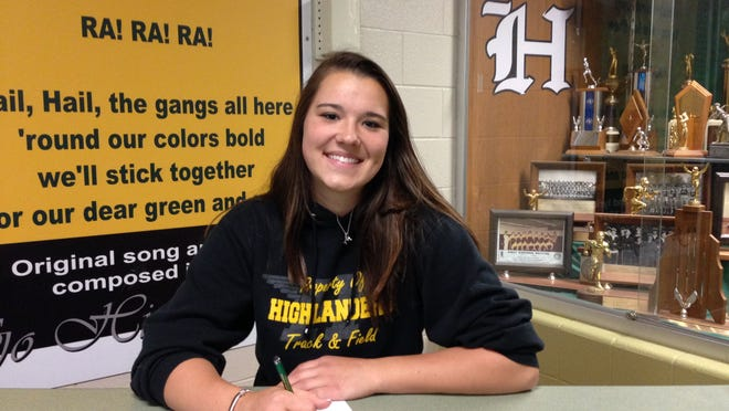 Marisa DeCamp, who competed in three sports at Howell, will compete in the pole vault after signing a national letter-of-intent with Spring Arbor University recently.