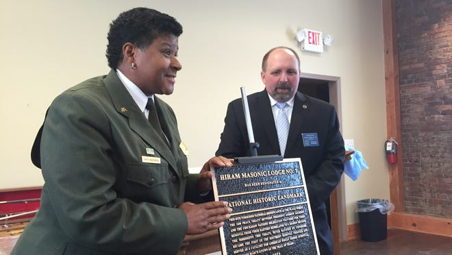 Gayle Hazelwood, Stones River National Military Park superintendent, and Hiram Lodge No. 7 Worshipful Master Jason Rein show the lodge's new plaque. The Franklin Masonic Hall was designated a National Historic Landmark in 1973 but just got its plaque Friday.