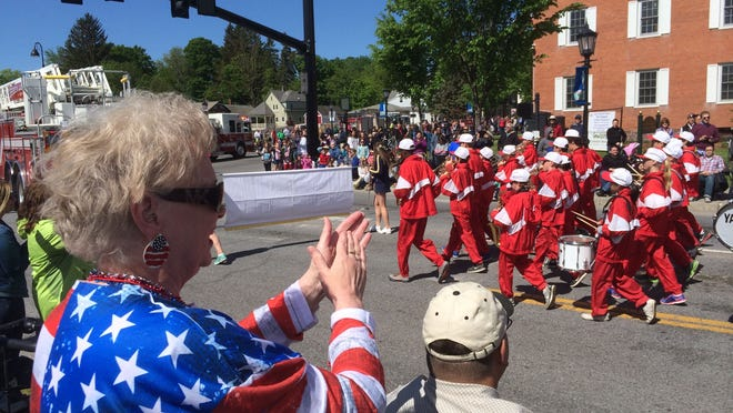 Marykate Rowan of Essex Junction cheers the Albert D. Lawton Intermediate School band Saturday during the Essex Memorial Day Parade.