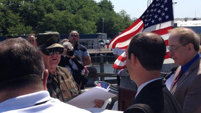 Vietnam veteran Ted Drapczuk of Glendora accepts his official certificate of citizenship.