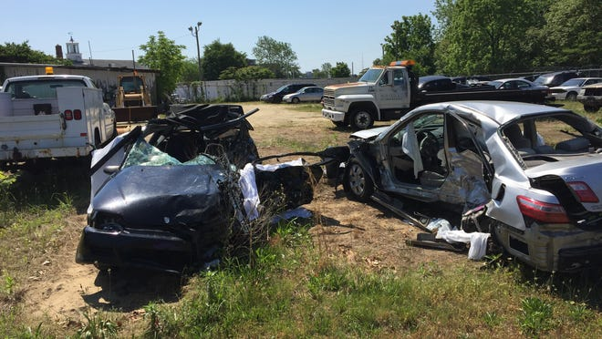The Millville impound lot holds the wrecked vehicles from Sunday's accident at Buckshutem and University roads.
