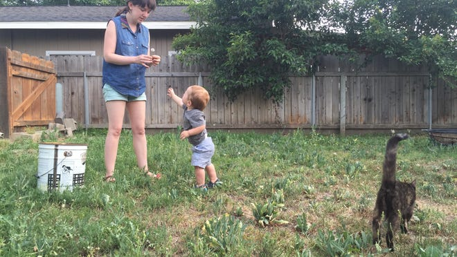 While Beth likes plucking weeds, Shiloh prefers to spread them.