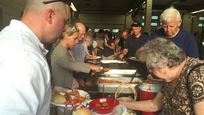 People line up for food Wednesday at the spaghetti dinner fundraiser at the Shelburne Fire Station. The Shelburne Police Department hosted the dinner to raise money for Thomas' cancer treatment. Thomas was diagnosed with Leukemia in late March.