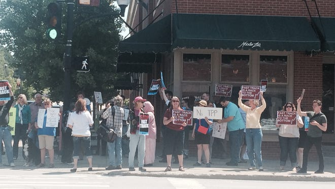 About 30 Iowa activists gathered outside U.S. Congressman David Young's downtown Des Moines office Wednesday, calling on him to publicly oppose the Trans-Pacific Partnership.