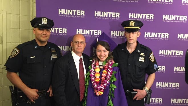 From left to right: MTA Police Officer Victor Pastrana, retired MTA police officer Ted Uzzle, Maya Leggat and MTA police Sgt. Dan Kearon at Hunter College graduation on May 27, 2015. Leggat survived being thrown in front of a train in White Plains by homeless man, Howard Mickens. Uzzle and Kearon came to her aid while Pastrana arrested Howard Mickens, who is now serving 25 years in prison for attempted murder.