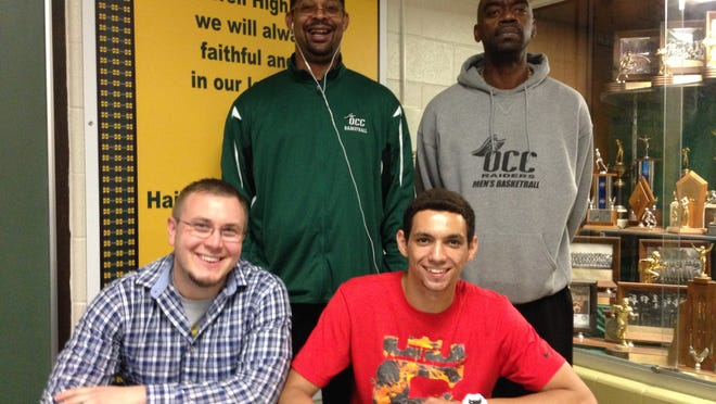 Deajay Klett, seated at right, recently signed to play basketball at Oakland Community College. Posing with him are Howell coach Nick Simon (seated, left), OCC coach Antoine Joubert (standing, left) and OCC assistant Javon Basnight.
