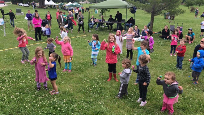 A group of youngsters jump and dance to live childrens songs performed at the inaugural Water Works Launch event Saturday.