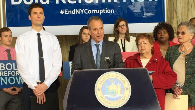 The state Attorney General Eric Schneiderman, center, was in Rochester on Monday, June 1, 2015,to push ethics reform legislation.