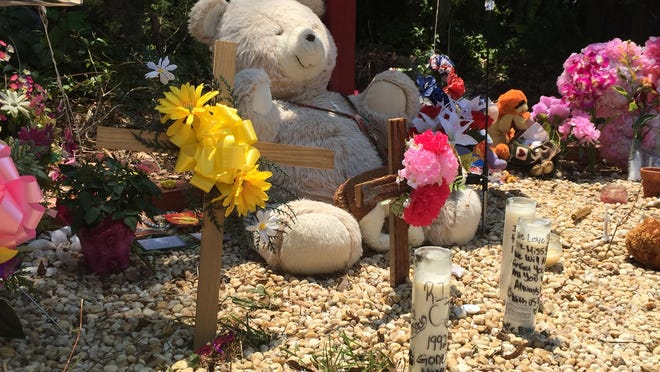 Teddy bears, flowers and other objects have been placed at a memorial for three people who died in a crash May 24 at Buckshutem and University roads in Millville.