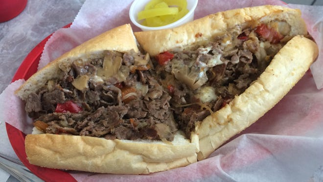 A Cheese Steak ordered with onions, peppers, mushrooms and a side of hot peppers from Philly Junction in Fort Myers.