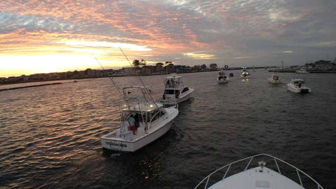 Boats head out of Manasquan Inlet last year for a day of fishing.