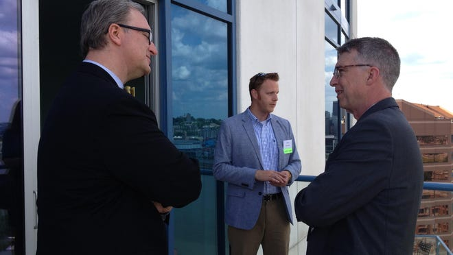 Trey Grayson, Northern Kentucky Chamber of Commerce president and CEO, meets Redwood executive director John Francis prior to the rollout of Vision 2015's new name and strategic plan. The event took place at the 22-story Ascent at Roebling's Bridge in Covington.