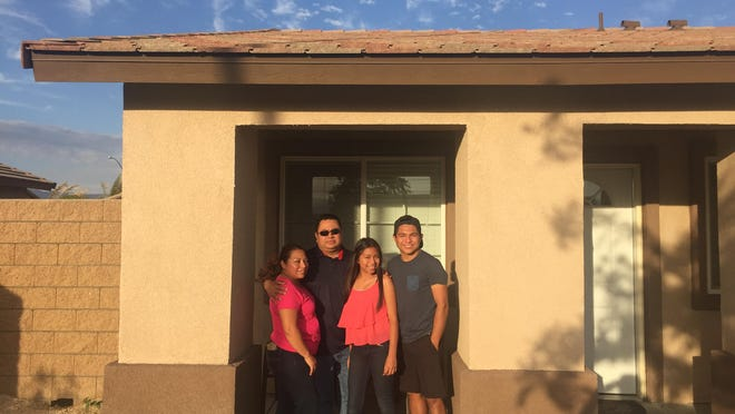 The Lemus family, from left Adriana, Leonel, Angela, Jesus and Josue (not pictured) are part of 205 families that have new homes at the Jardines housing development in Coachella. The houses were part of the Coachella Valley Housing Coalition new 205 homes.