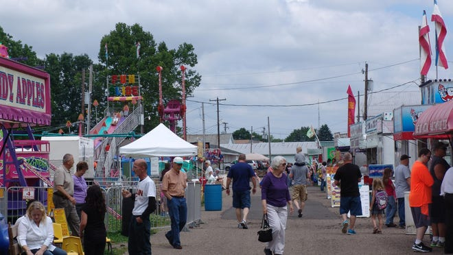 Attendees of the 34th Coshocton Hot Air Balloon Festival make their way through the midway.