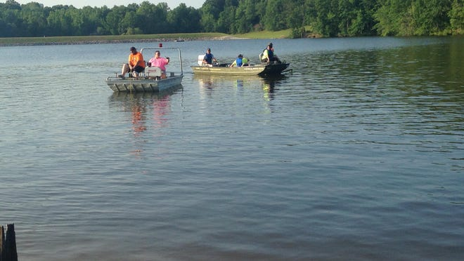 Rescue crews examine Pine Lake in Henderson County on Sunday after a report of a possible drowning.