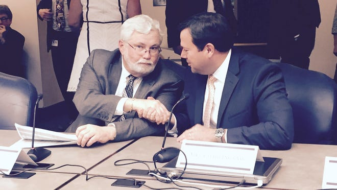 Sen Jack Latvala, R-Clearwater, (left) and Rep. Clay Ingram, R-Pensacola, shake hands before a Monday night meeting of the Tourism and Economic Development conferees.