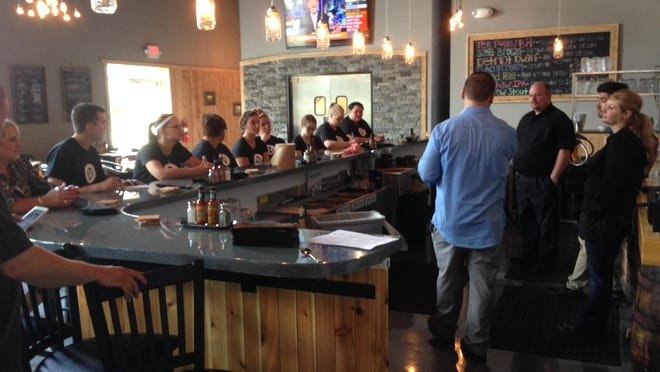 Old Nation Brewery's new staff gets together before a mock opening on Monday.
