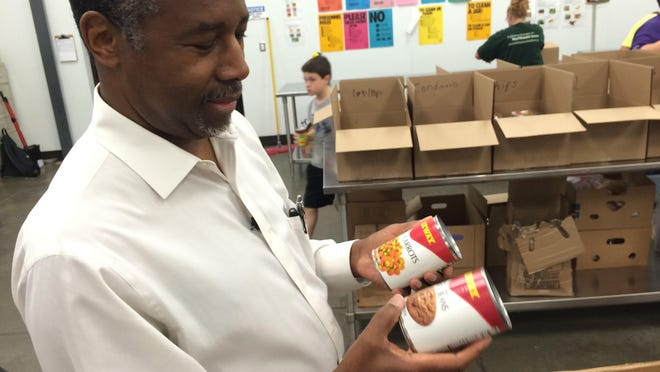 Republican presidential candidate Ben Carson spent time volunteering in Waterloo on Wednesday. He and his campaign team sorted hundreds of canned goods after a tour of the Northeast Iowa Food Bank.