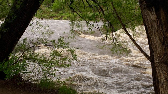 The Poudre River in this photo taken in May continues to flow high and fast, fueled by snow melt and storms.