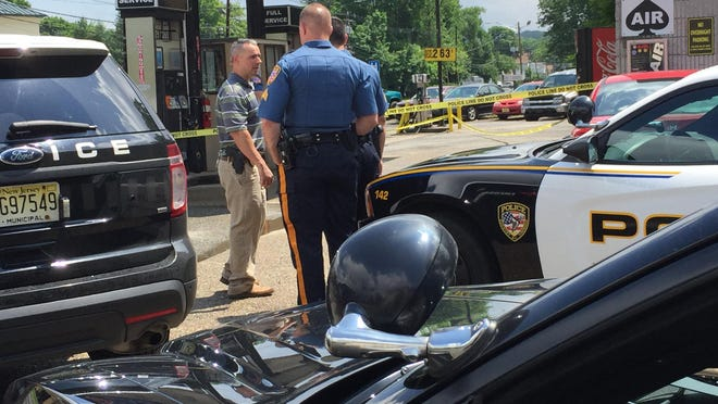 Roxbury and Wharton police respond to the scene of an armed robbery Tuesday at the Delta gas station on Route 46 East in the Kenvil section of Roxbury.