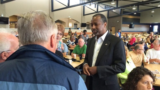 Ben Carson shakes hands the hands of potential voters in Fort Dodge Thursday morning.